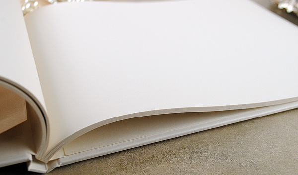 Our guest books come with beautiful pearlescent paper throughout.