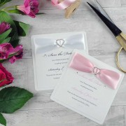 Diamonté save the date in baby pink and white
