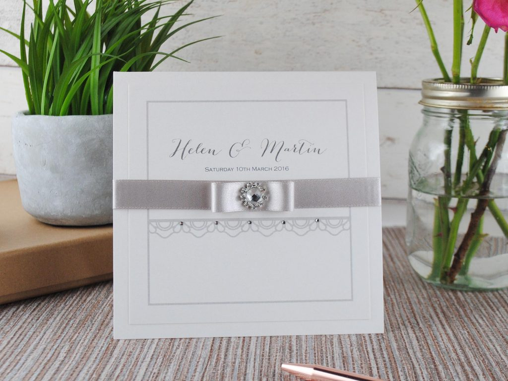Handmade pocketfold wedding invitation with lace and ribbon
