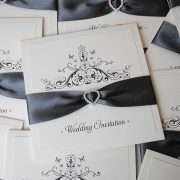 Handmade wedding invitation with dark grey ribbon